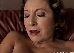 Alluring granny Laura shows her sweet pussy