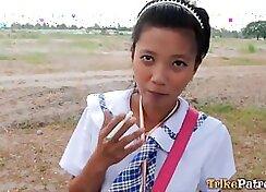 Asian schoolgirl sucking outdoors