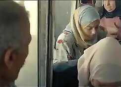 Arab girl is making a play for nobody in the bus