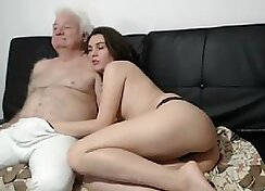 Perverted brunette masturbates with stick and fingers