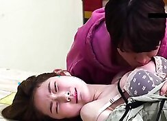 Appealing korean babe plays with her tits